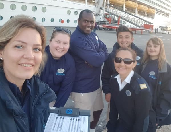 Shore excursions team onboard Navigator of the Seas (Royal Caribbean cruise ship) doing dispatch in the port of Bruges, Belgium