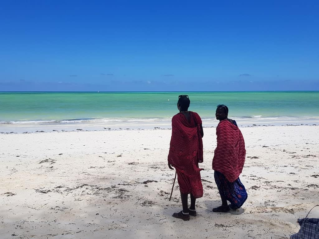 The Masai - Africa's most famous tribal people standing on Paje beach