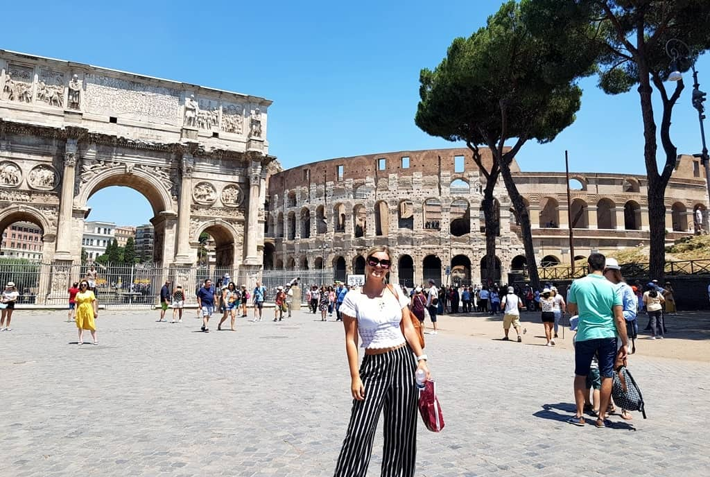 The picture of me in front of Colosseum and Arco di Constantino