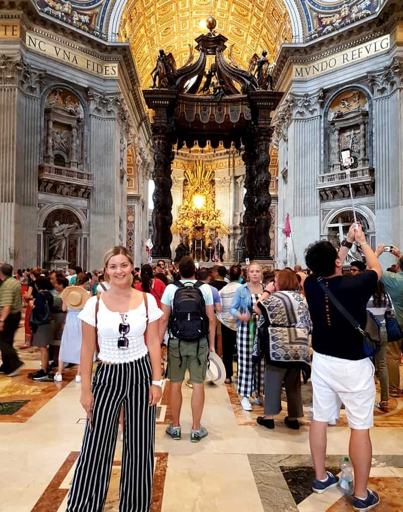 Inside the St. Peter's Basilica with St. Peter's Baldachin in the background