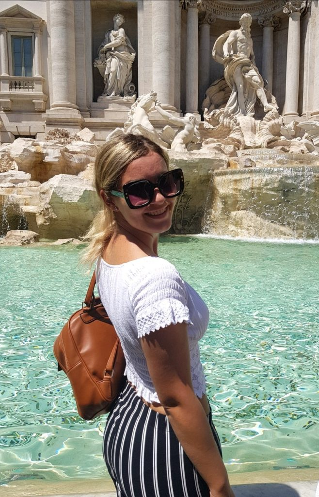 The picture of me in front of the Trevi fountain